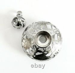 Perfume bottle with crystal and sterling silver overlay in floral design