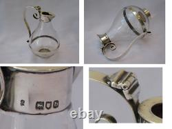 Victorian Sterling Silver and Glass Oil Jug 1897 London. A Silver and Glass Oil